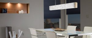 Stylish and modern lighting fixture placed over white dinning table.