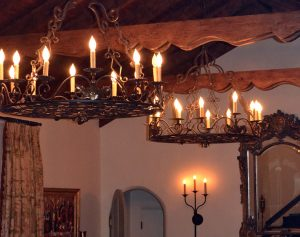 Two custom traditional chandeliers in living room space located in Carmel, CA.
