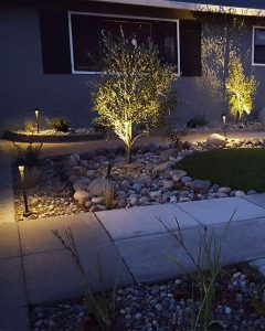Landscape lighting fixtures highlighting home walking path in Salinas, CA.
