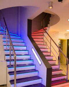 LED lighting highlighting stairway in modern house.